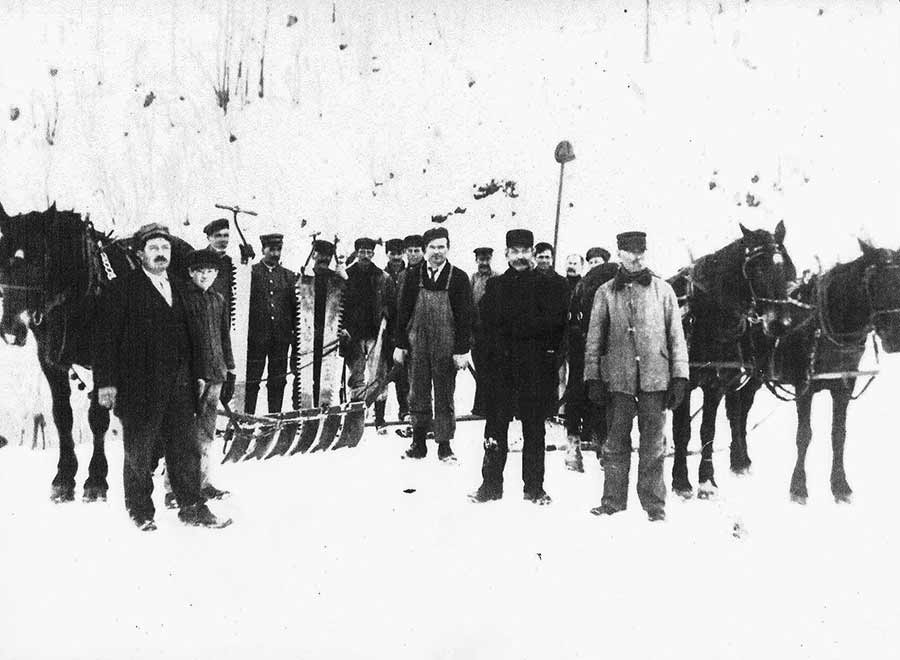 JP Gengler and the crew with the equipment they used to harvest ice from the man-made ice pond.